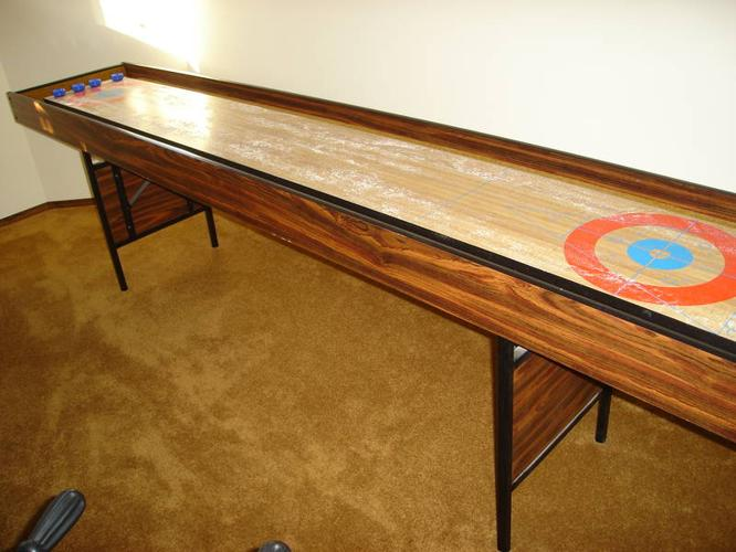 BOB WOOD SHUFFLEBOARD TABLE WITH ROCKS AND MANUEL COUNTER