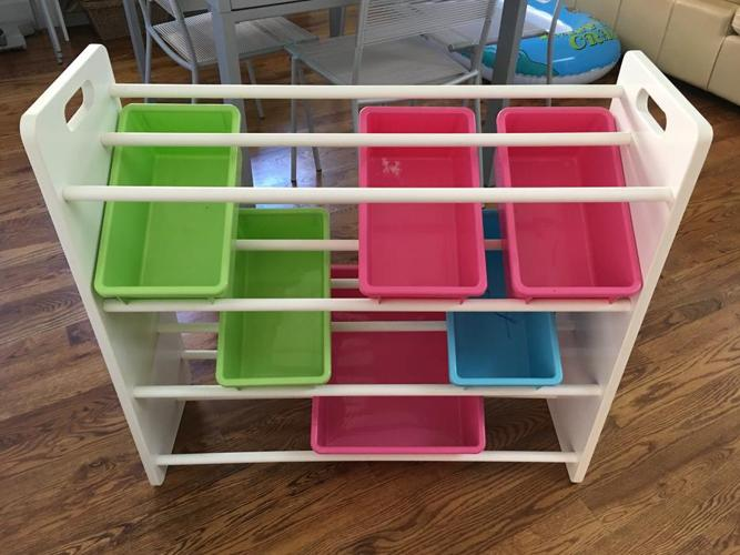 Children shelving unit with colourful bins.