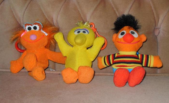 three sesame street character clips ons