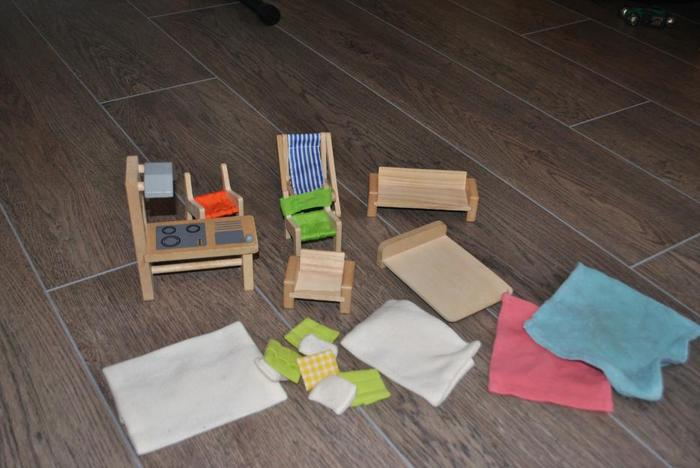 Variety of wooden plan toys doll house items