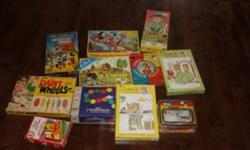 """I have 11 games and Puzzles for kids. Vintage . Asking $20.00 Winnie the pooh picture puzzle blocks 10"""" Circular Puzzle 1000 wooden beads The Simpsons 28 super sized dominoes Paint Wheels Walt Disney Master Mind Game (Parker Brothers) Walt Disney puzzle 4"""