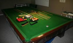 "6'x12' slate billiards table   Includes: 6- standard cues               2- short cues               1- long cue               1- rake               1- prop               1- snooker ball set               1- 2"" ball set               1- 1 7/8"" ball set"