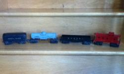 1948-1959 Lionel Train cars. Four total. Scout car missing 1 set of trucks and some minor rust on others. No engine. Great vintage toy and would look great on display or for completing a set. First post war set made by Lionel. This ad was posted with the