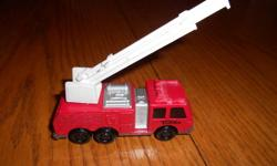 This firetruck has all the bells and whistles of a Tonka!! Extendable and rotational ladder. 6 wheels. In great condition. $7.00 o.b.o