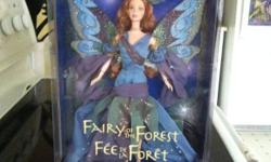 1st doll in the series from 1999. Has never been opened, box is in fairly good shape as pictures show. Please only serious inquires where this is a collectors doll.