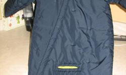 Size 24 months, Navy blue bunting bag by Columbia with matching hat.  This suit has flaps that fold down over the hands so no mittens are needed.  There is a hole below the crotch so the seatbelt buckle will fit through in the car seat.  My son wore this