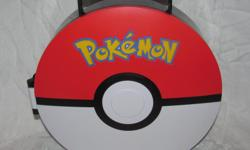 Hello, we are selling a plastic case made in 2011 by Jakks Pacific. The front look like a Pokeball and inside is small compartments for the small PVC Pokemons. The case is pretty tall, I included a pop can in one photo to show its height. I don't have any