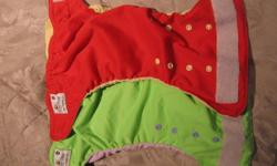 Large lot of cloth diapers includes:   ·         6 green and 6 red BayBee adjustable pocket diapers.  These were my favorite diapers but still have a ton of life in them - the more I washed them the softer and more absorbant they became. ·         2 Snugs