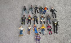 A lot of action figures for $20 superman, Indiana Jones, Police, firemen, Lord of the rings, Construction workers, SWAT. 26 action figures for $20