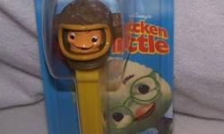 2 DISNEY MOVIE CHICKEN LITTLE COLLECTIBLE PEZ WITH CANDY PRICE: $5 FOR PAIR FISH OUT OF WATER & UGLY DUCK