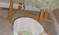 2 Moses Baskets & a wood Rocking Stand (jolly Jumper)