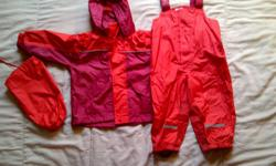 nice fireman red splash pants and raincoat! (size european 86) grown out sale from my twin daughters. check my other ad!