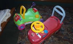 Green one push/ride toy.  Red one push/ ride toy with little trunk under seat.  Both stored inside but used on cement outside.  $10 each or both for $15