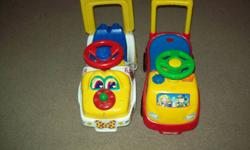 2 ride on cars.....The puppy car has seen outside...  The other one was used in the house, it also has sounds, plays music.... They both come from a smoke free home...   Pic 2&3 is a lap toy where they can pretend they are driving... makes sounds...  $5