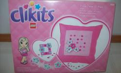Lego Clikits Pillow/Purse/Frame and Designer Pencil Set.  Set 1:  Can create either a pillow or purse -- all in one!  Also includes a matching fashion frame.  105 pieces.  Ages 6 and up.  Set 2:  Can create a designer desk set.   Both items are brand new