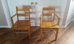 2 Solid wood arm chairs. Great for home daycares. Good condition. measures 18.5 from floor to seat. Asking $35.00 each