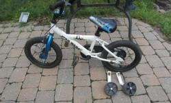 Star Wars two wheeler bike with training wheels. Excellent for boys and girls. 16 inches high. Seat can be adjusted.