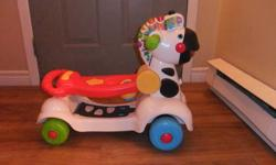 The VTech 3-in-1 Learning Zebra Scooter converts easily from push walker to ride-on scooter. Kids can discover their wild side as they move with the zebra and explore new territory with the scooter's walkie-talkie, compass and flashlight. The zebra's mane