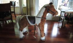 Like new, whinnies and has stirrups.