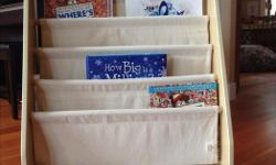 Ideal storage for younger readers, as books can be displayed by front cover, rather than the spine and the soft canvas 'shelves' prevent damage. Excellent condition.