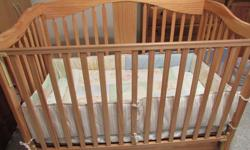 Natural colour. Includes firm simmons crib mattress & 4 piece bedding set: Comforter, bedskirt, bumper pad, crib sheet. Crib converts to a day bed, then to a full size bed with a headboard/footboard. Smoke & pet free home. Asking $160.00 or best offer!