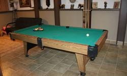 In excellent condition. Comes with pool cue rack, balls and ball rack and chalk. Please contact to view. Call or text Melissa @ 403-580-0914 or respond to this ad.