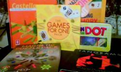 """Fun games!!   ON THE DOT: Winner of """"10 Best Games"""" by Dr. Toy. Play alone or with up to four players. Match the dot picture on the card with two clear cards placed on top of eachother. Sounds easy.....think again. Excellent condition.   THE GAMES FOR ONE"""