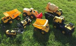 7 Tonka Toy trucks and diggers. Good shape.