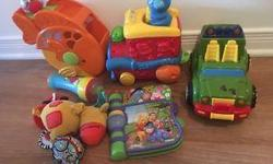 A lot of nice baby first year toys in an excellent condition.Fisher-Price Peek a Blocks Stacks & Smile Crocodile, Fisher-Price Laugh & Learn Singin' Soccer Ball, Fisher-Price Laugh & Learn Sweet Sounds Picnic Basket Shape Sorter Blocks , Fisher-Price