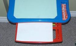 Alphabet learning table comes with seat, alphabet pages, drawer (for pages),  white board area, and crayon/pencil compartment.  When letter is pushed, the letter is said, sounded out and an example of a word that starts with that letter is given (which is
