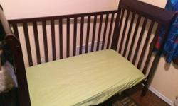 This crib is in excellent condition. The mattress has been covered by a protector and is in great condition also. The crib is adjustable in heights from newborn to toddler. It even allows for one side to be removed for an older toddler. All hardware is