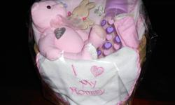 """This adorable baby girl basket is for sale for $15.00. It is perfect for any baby shower, birthday or any other occasion. It includes the following: *Pink teddy bear *Baby bottle *Baby blanket *Baby wash cloths *Baby bib """"I Love My Mommy"""" All for the low"""