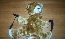This is an adorable bear backpack. Soft. Zips open at the neck.Adjustable straps. Great for holding small toys or PJs when going to spend an overnight. I also have another simliar to this in Winnie the Pooh. See my other ads