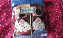 "BRAND NEW Robeez baby girl ""Cupcake"" leather slippers in package. Size 0-6 months. Pick up is near Shelmerdine Greenhouse on Roblin Blvd. or can meet up at Kenaston/McGillavary area during the week. Thank you and please see my other ads"