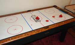 Air hockey game or flip it over and it is a pool table.
