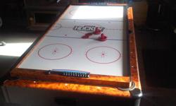 Air hockeypool table from Canadian Tire 6' X 3' over $400 + Tax very good condition. $150.00 OBO