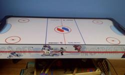 Air Hockey Table, first $25.00 takes it. in good shape, just doesn't get used. comes with four discs and two paddles.