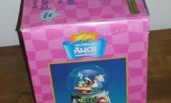Alice in Wonderland snowglobe. Mint Condition in box. Plays Nocturne.