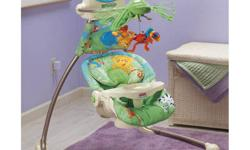 The Rainforest Open-Top Cradle Swing has two ways to swing and so much more! The soft goods have brightly colored rainforest creatures and an infant head pillow. The swing features 6 speeds and 12 songs in both soothing and playful styles. Two nature