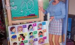 This American Sign Language (ASL) Barbie was issued and sold in 2000, exclusively at Toys 'R' Us, which makes her 16 years old. Mattel worked with the National Center on Deafness at California State University, Northridge, to ensure the ASL Barbie