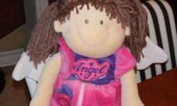 Great doll for teaching your little one! From non smoking home. It has a ribbon on one slipper to help learn to tie bows and a snap on the other slipper. They can also learn to button and use a zipper and velcroe. She has a crown and wings, so it's fun