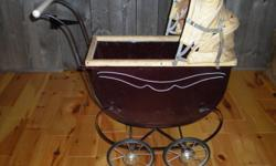 antique doll carriage ,burgandy in color,in great condition ,except for the hood