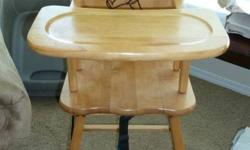 This high chair is solid wood refinished with a clear laquer.  It's in great condition and looks really nice because it's not plastic.  It has the Classic Winnie the Pooh stamped into the back of the chair.  It also doesn't have such a wide base so it