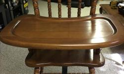 Antique wood high chair in immaculate condition. Chair is at least 30 years old and is in near perfect condition.