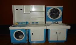 Battery operated washer and dryer, and bathroom vanity, heavy plastic, , probably 20 years old 10 inches high. Can add water and taps work. Very unique