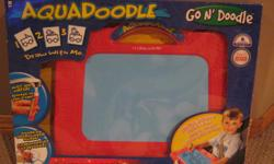 Aqua Doodle. Like new. Excellent shape still in original box. double sided drawing surface. great fun. for ages 3+. paid $20 plus taxes.