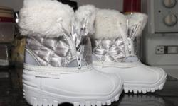 Arctic Tracks Winter Boots Infant Size 5 - White & Silver - only worn a few times by an infant that couldn't walk.  No wear and tear.  Good for cold conditions.  Nice lining, zippers on both sides for easy foot access, tread like new.