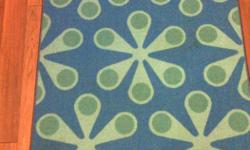 """55"""" by 39"""" bright turquoise blue and green flowers rug, some stains and vacuum sucked up some of the piling in a corner so there is a bare spot, $5"""