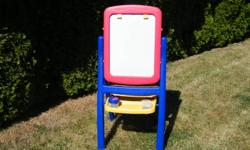 Art Easel - Combination magnetic dry erase white board/chalk board with poster paper holders. Includes magnetic letters, 2 paint cups and a white board eraser.