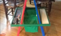 In great condition. Whiteboard on one side, chalkboard on other. Also has hooks for paper pads. Baskets for storage.